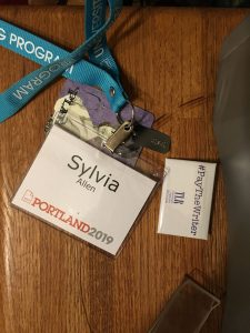 AWP conference badge, with badge swag